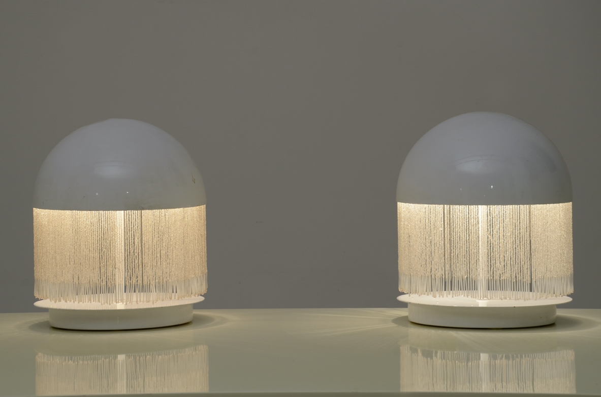 Pair of 1960's Italian white laquered table lamps with thin glass pendents.