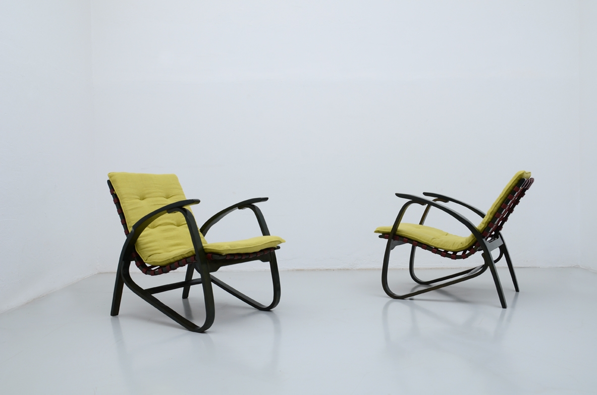 Jan Vanek, stunning pair of easy chairs in bent wood, polished with their original dark green color, Prague 1935.