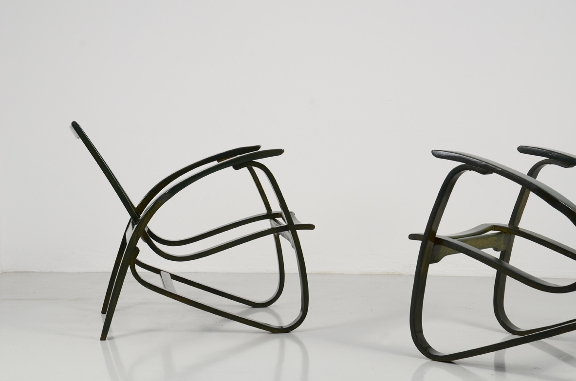 Jan Vanek, stunning pair of easy chairs in bent wood, polished with their original dark green color, Prague 1949.