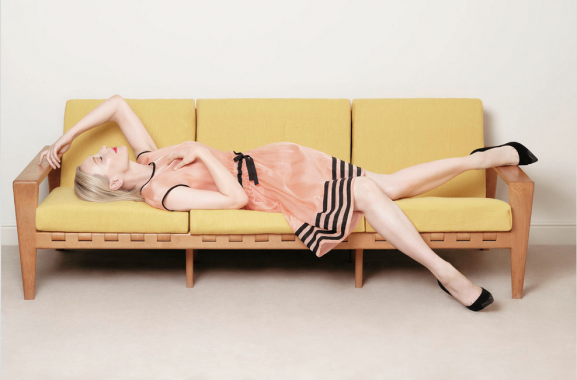 Cate Blanchett sitting on 1950's modernist sofa