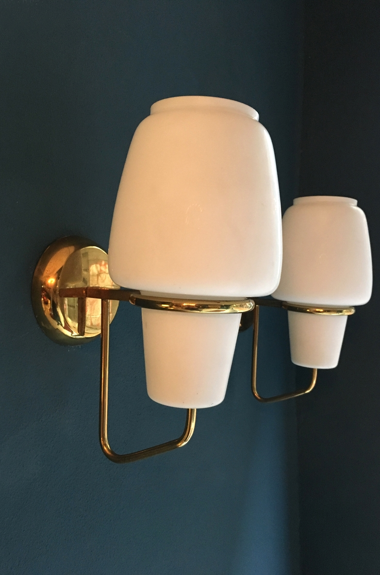 Pair of 1950's wall lights in brass and opaline glass produced by Arredoluce.