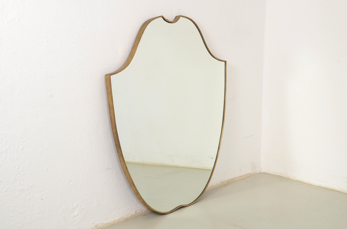 Italian 1950's brass framed mirror.