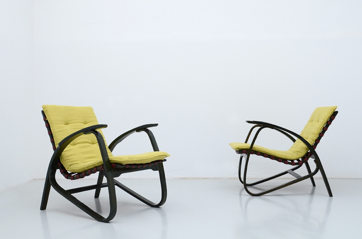 Jan Vanek, stunning pair of dynamic easy chairs in bentwood, polished with their original dark green color, Prague 1935.