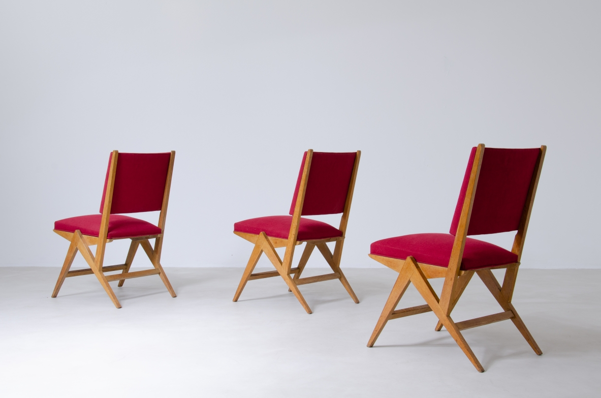 Set of six chairs in Oak with red fabric upholstery, France, 1950's.
