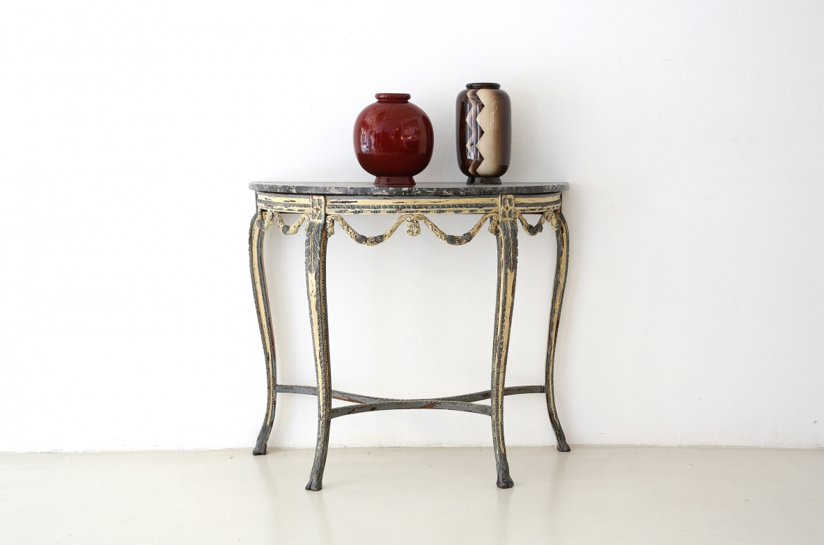 Luis XVI console table in painted thin carved wood, France 1770's.