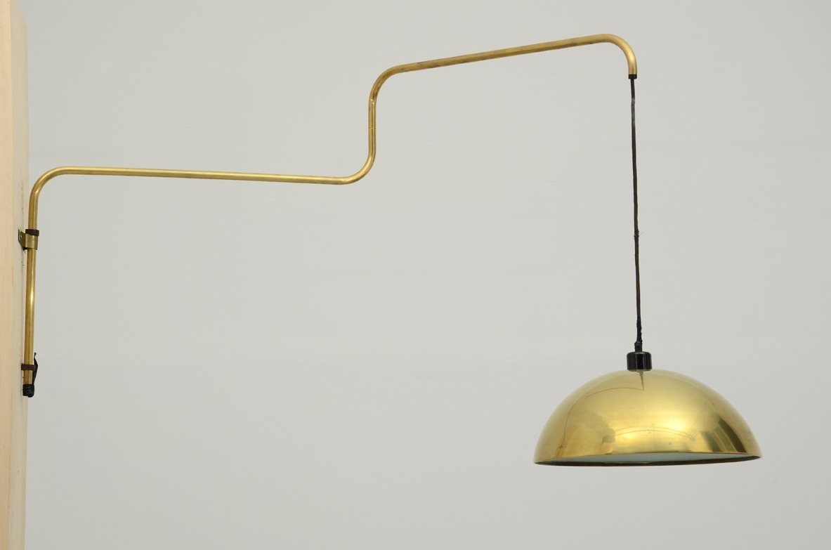 Martinelli Luce, adjustable wall lamp in brass. Italy, 1960's.
