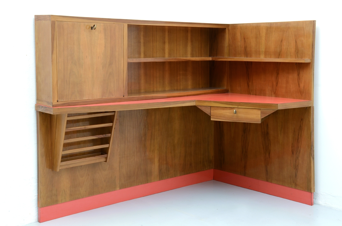 Stunning corner desk with newspaper holder, bar and shelves.