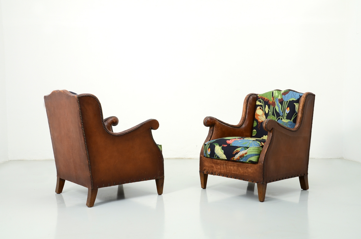 Pair of 1930's club armchairs.