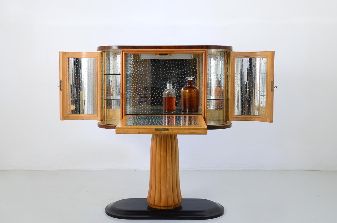 Bar cabinet based on a central column, Italy 1940's.