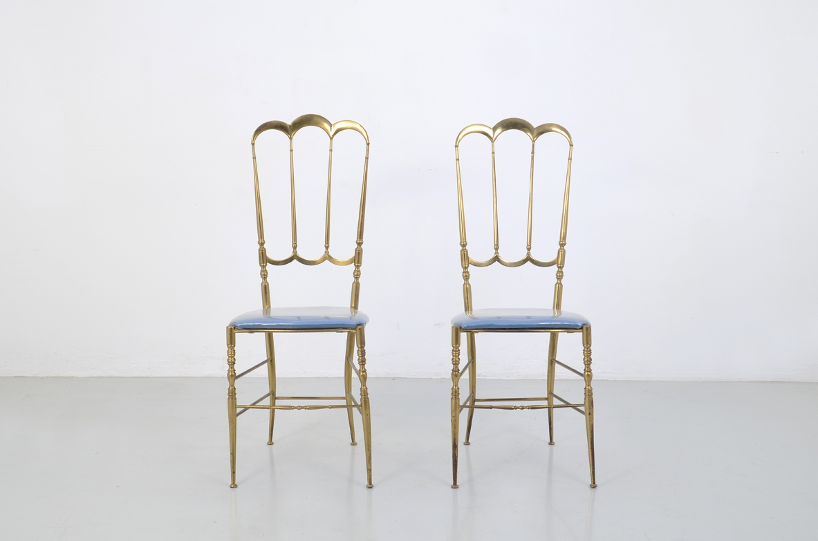 Pair of rare high back chairs in bronze, Italy 1950's.