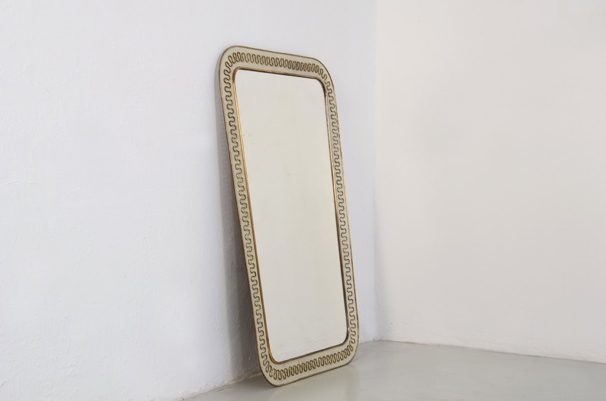 Elegant Italian 1950's mirror with metal and brass frame.