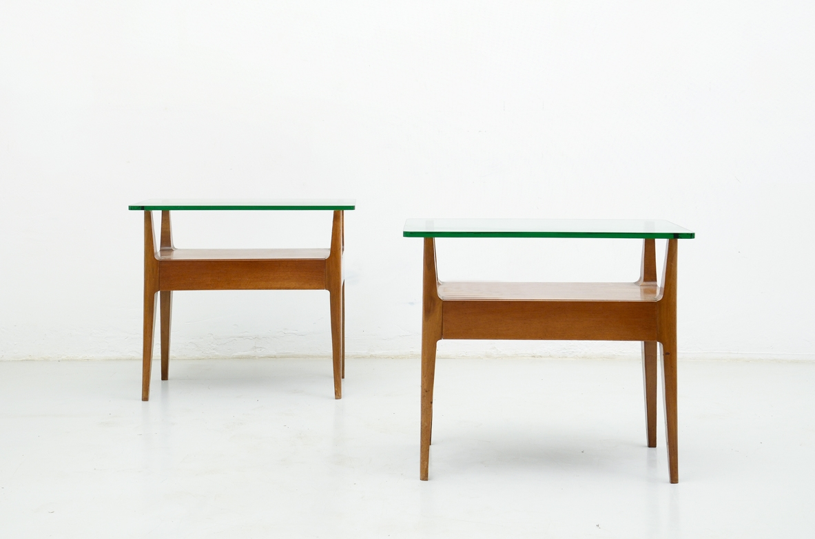Pair of wooden bedside tables with glass shelf, Italy 1950