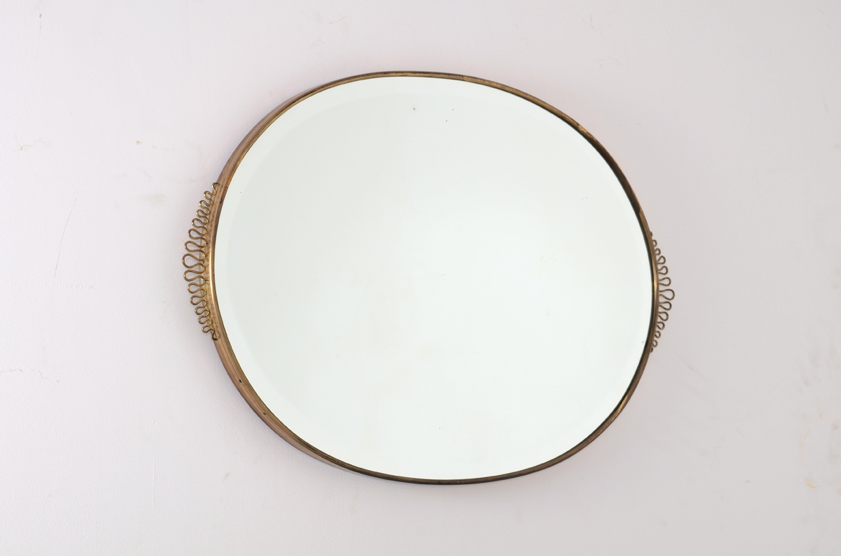 Italian 1950's oval mirror with brass frame.