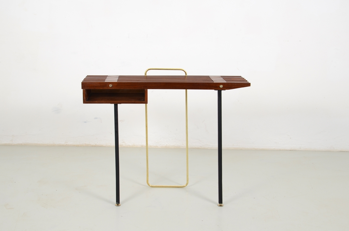 1950's Italian console table in teak wood, metal legs on front and brass O on the back.