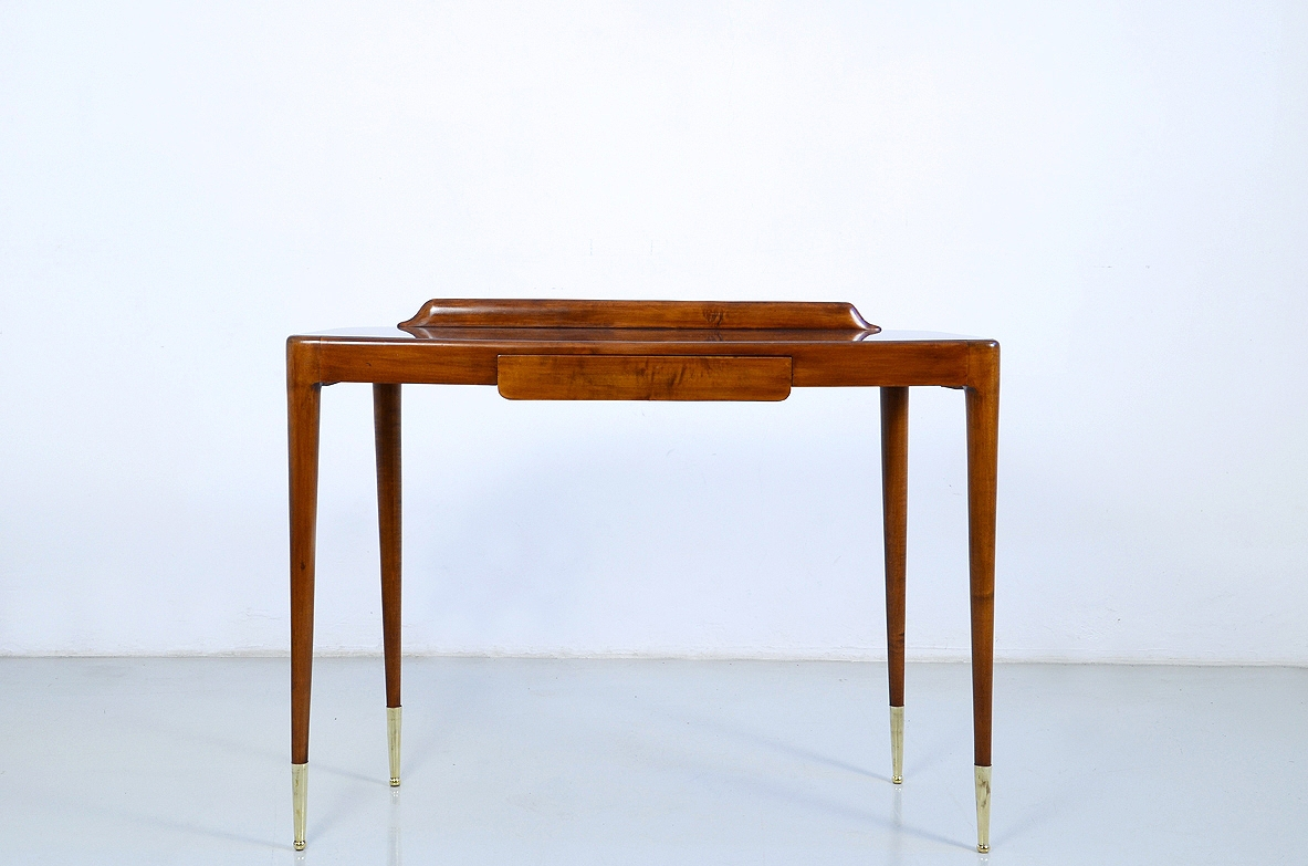 Elegant Italian 1950's console table with thin legs on long bronze tips.