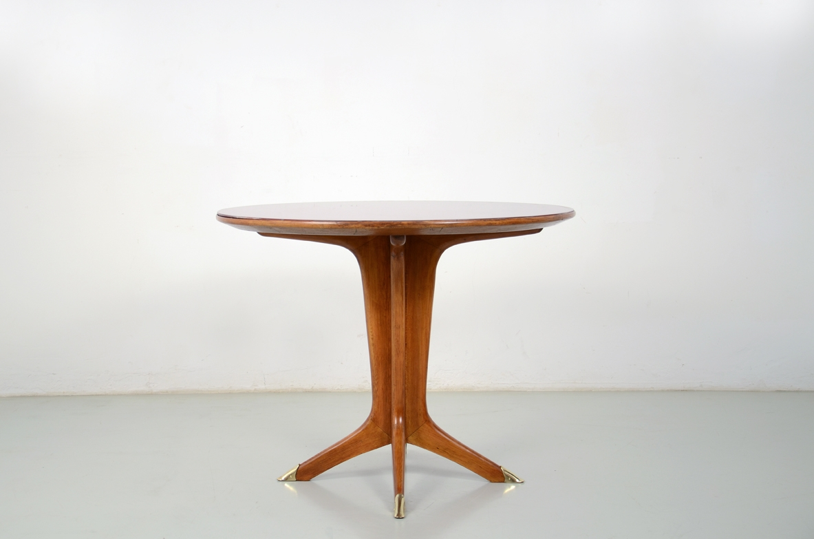 Italian 1950's round dining table with nice crossed legs and opaline glass top.