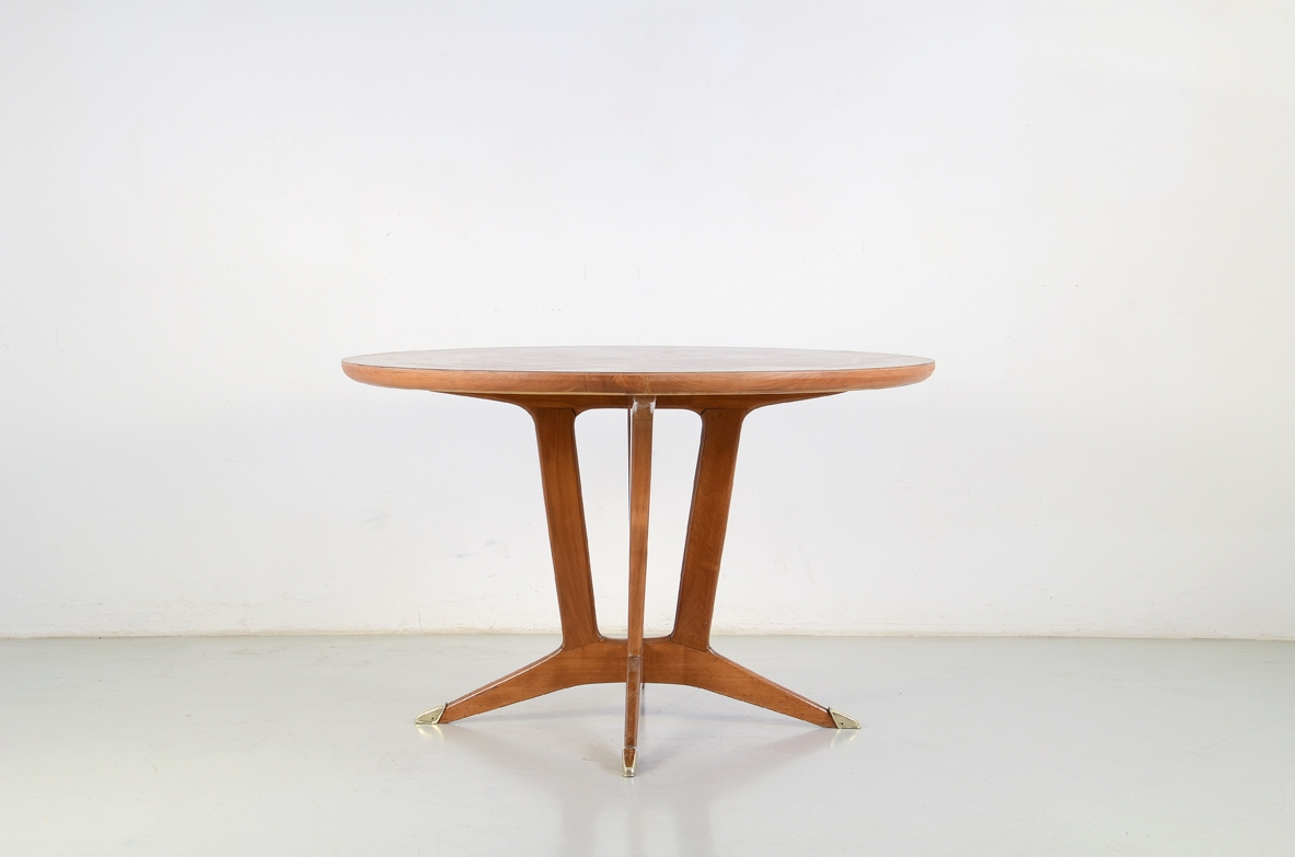 Elegant Italian 1950's table in cherry wood with bronze tips.