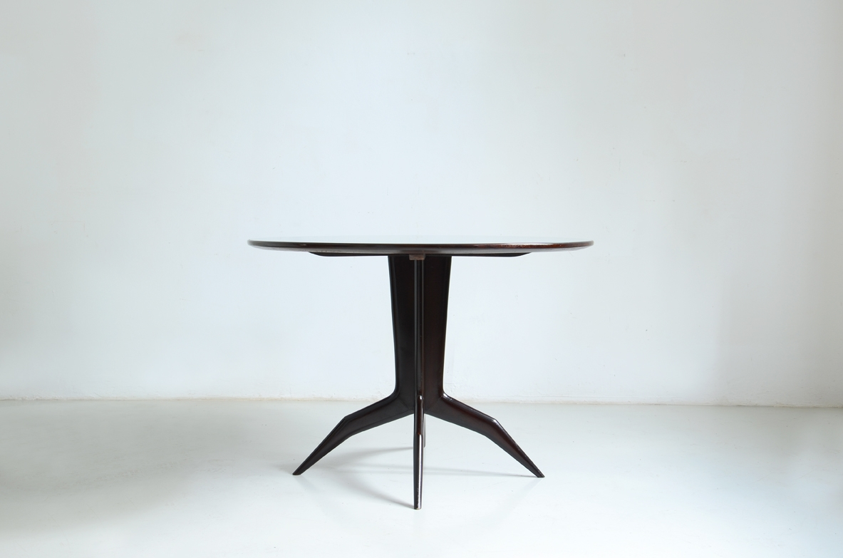 Elegant 1950s round table in ebonized wood and opaline glass