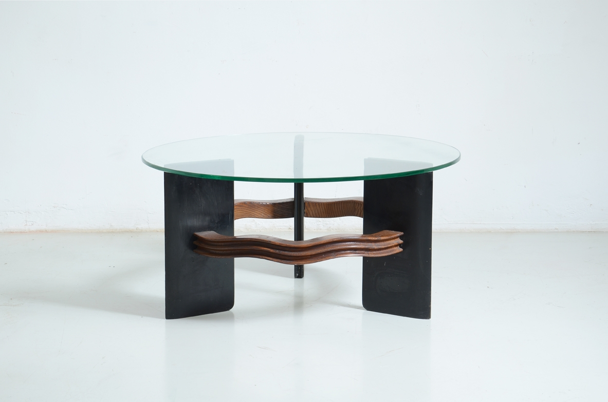 Elegant table with support in wood and aniline-stained wood and glass top.