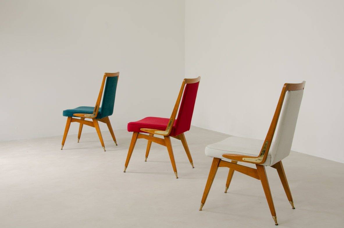 Group of 9 chairs of Italian manufacture. Made of wood, with brass tips, 1950s.