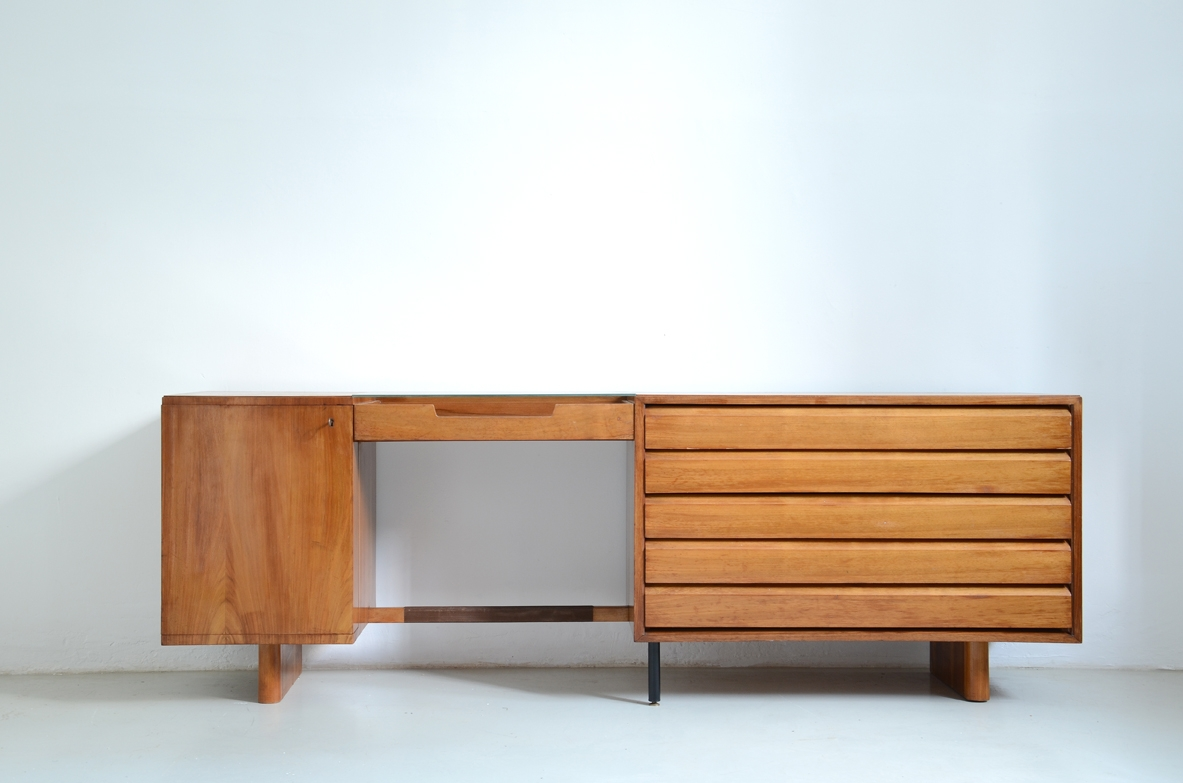 Italian 1950's sideboard in light walnut with five drawers, a nice desk and a bar cabinet.
