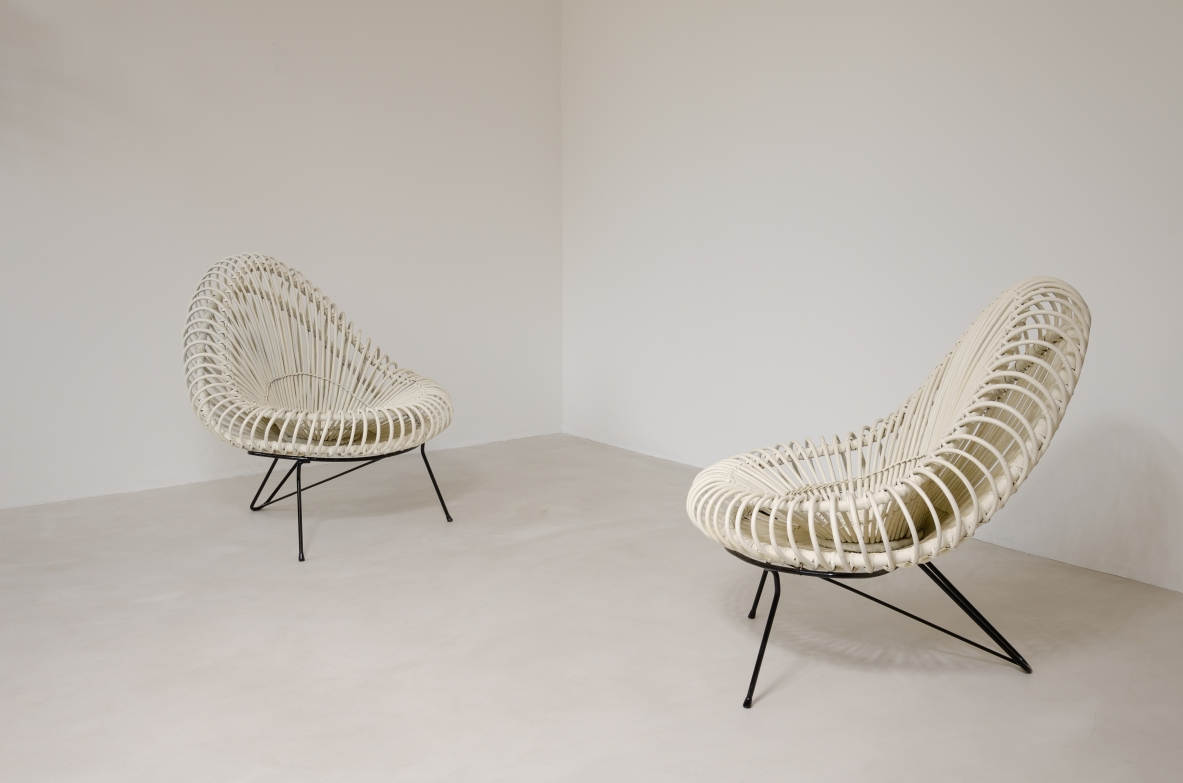 Janine Abraham, pair of armchairs in lacquered rat with metal supports.