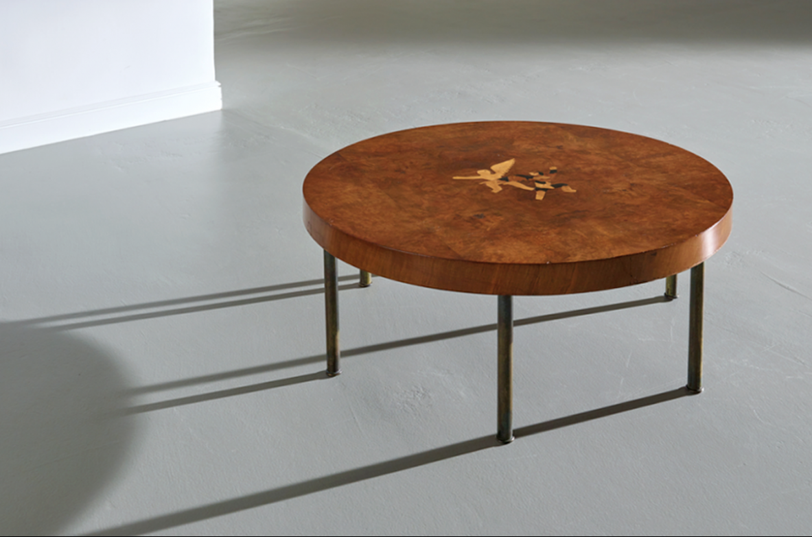 Italian 1930's  coffee table with six brass legs and with allegorical inlay on the top.