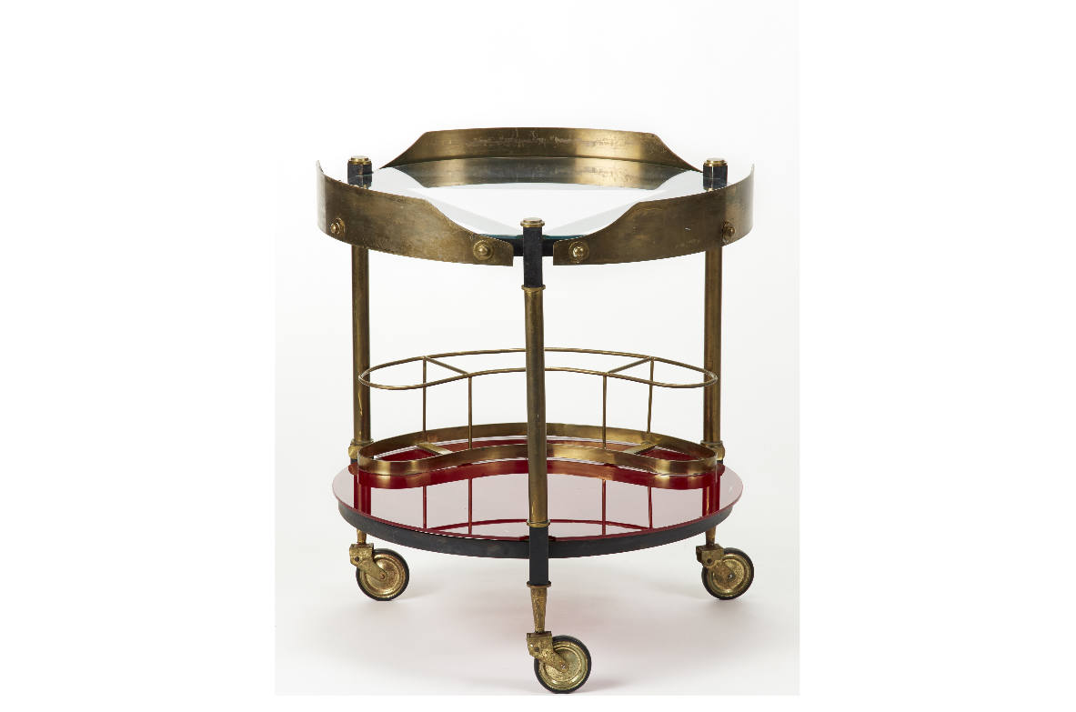 Splendid trolley in brass and painted metal.