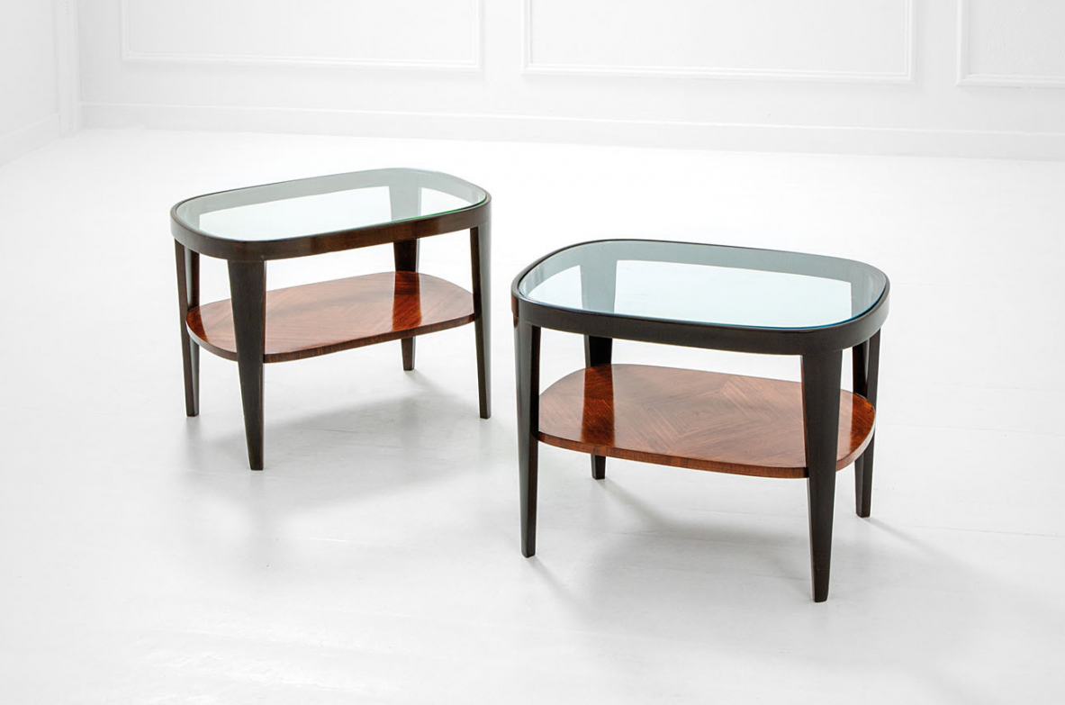 Pair of low tables with glass top.