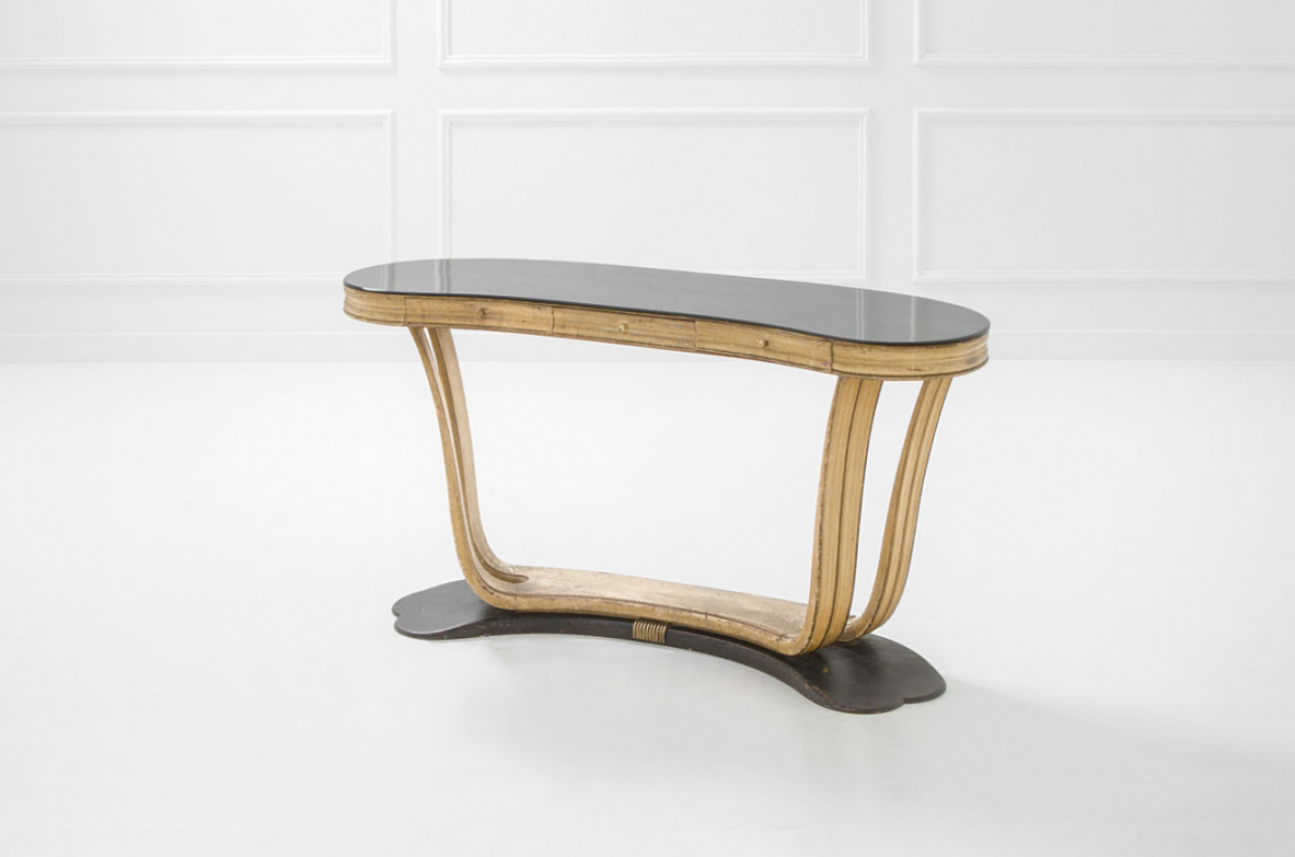 Osvaldo Borsani, elegant table / console in lacquered wood, with glass top and brass structure. Manufactured by Arredamenti Borsani, Italy 1940ca.