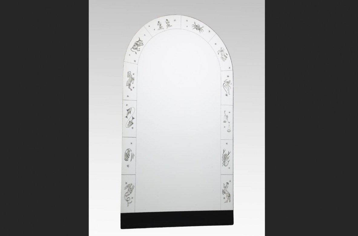 Wall mirror with engravings of zodiac signs, made of crystal and wood. Italy, 1940.