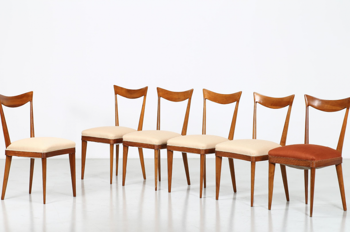 Group of six chairs in walnut wood with upholstered fabric seat
