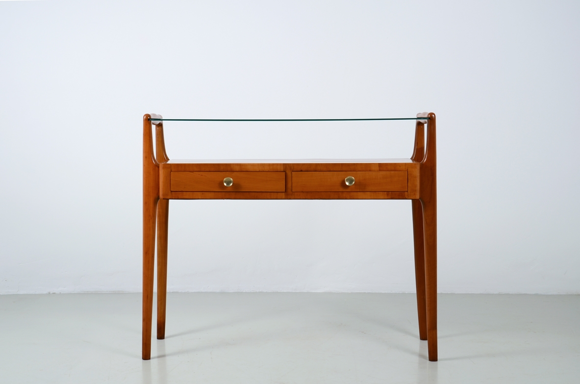 Italian manufacture, cherry wood console with two drawers and glass top.