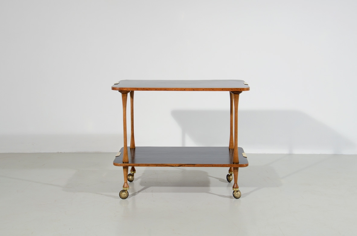 Italian manufacture, teak trolley with lacquered tops and brass details